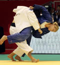 U.S. judoka Kayla Harrison, right, throws Brazil's Mayra Aguiar during the women's under 78 kg category final of the World Judo Championships in Tokyo Thursday, Sept. 9, 2010. Harrison won the bout and became the first American woman to win a gold medal at the judo world championships since 1984. (AP Photo/Junji Kurokawa)
