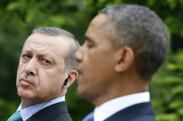 <p>Turkish Prime Minister Recep Tayyip Erdogan (L) listens to U.S. President Barack Obama during a joint news conference in the White House Rose Garden in Washington, May 16, 2013. (Kevin Lamarque/Reuters) </p>