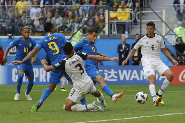 Brazil's Philippe Coutinho stabs home the first goal of the game (AP)