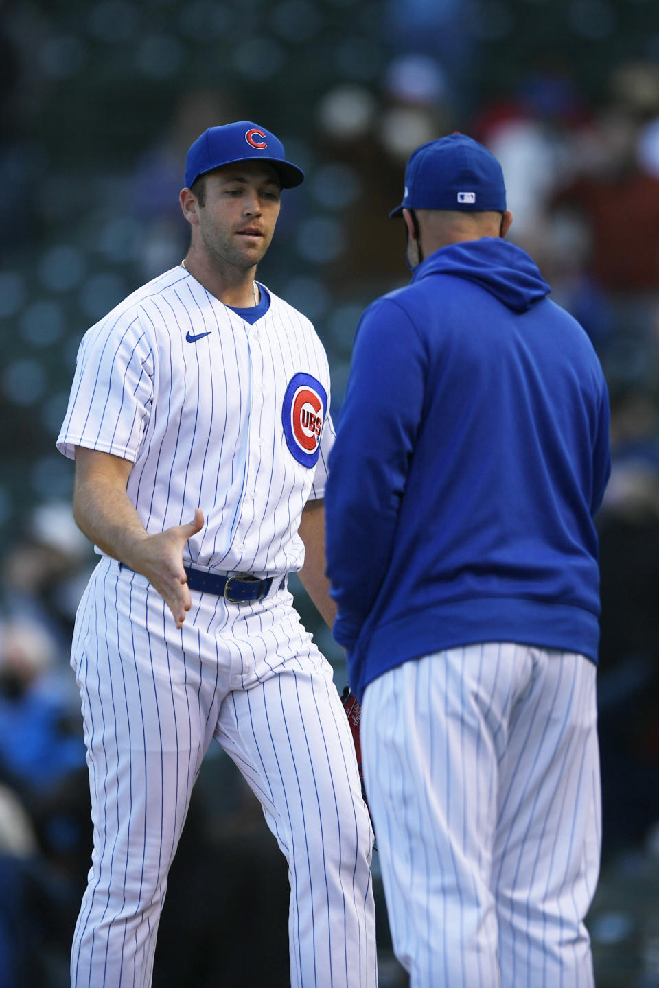 Chicago Cubs closing pitcher Jason Adam left, celebrates with manager David Ross right, after defeating the Atlanta Braves in a Major League baseball game Saturday, April 17, 2021, in Chicago. (AP Photo/Paul Beaty)