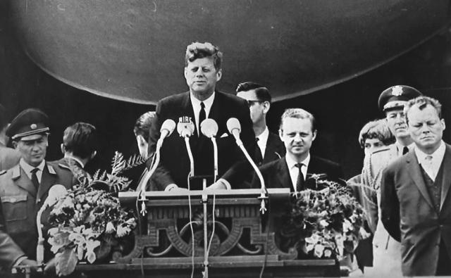 "<p>President John F. Kennedy delivers his famous ""I am a Berliner"" (""Ich bin ein Berliner"") speech in front of the city hall in West Berlin, June 26, 1963. At far right is West Berlin Mayor Willy Brandt. (Photo: AP) </p>"