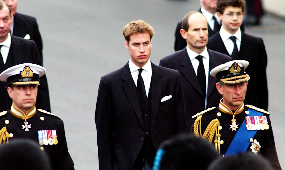 403541 12: Britain's Prince Charles (R) Prince Andrew (L) and Prince William (C) walk behind the Gun Carriage bearing the coffin of the Queen Mother April 9, 2002 as it makes its way to Westminster Abbey during her state funeral April 9, 2002 in London. (Photo by Anthony Harvey/Getty Images)
