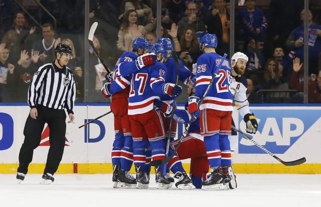New York Rangers celebrate after a goal by left wing Chris Kreider (20) during first period of an NHL hockey game against the Buffalo Sabres, Saturday, March 24, 2018, in New York. (AP Photo/Noah K. Murray)