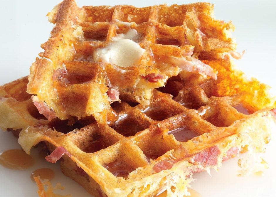 """This waffle recipe is a ham and cheese sandwich disguised as the greatest brunch dish of all time. <a href=""""https://www.bonappetit.com/recipe/ham-and-cheese-waffles?mbid=synd_yahoo_rss"""" rel=""""nofollow noopener"""" target=""""_blank"""" data-ylk=""""slk:See recipe."""" class=""""link rapid-noclick-resp"""">See recipe.</a>"""
