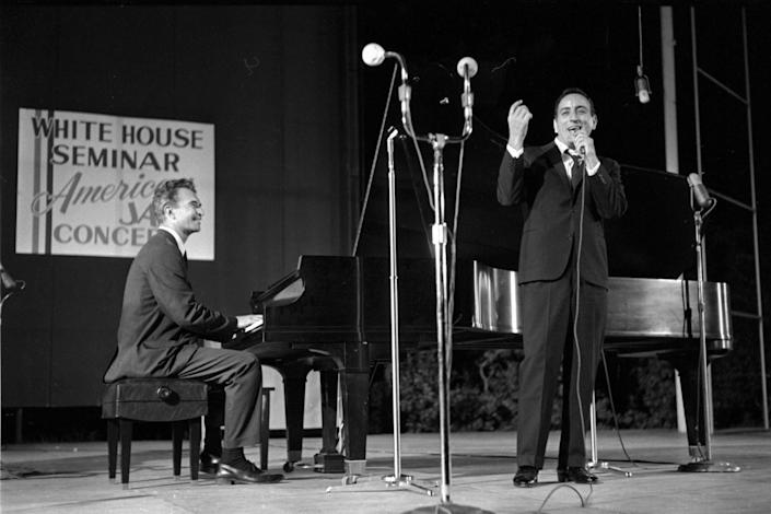 """This 1962 photo released by Columbia Legacy shows Dave Brubeck, left, and Tony Bennett performing in Washington. Bennett never forgot the first time he performed with Dave Brubeck more than half a century ago. But the tape of that memorable collaboration between two American jazz masters lay forgotten in a record label's vaults until its discovery by an archivist just weeks after Brubeck's death in December, and it's just been released as """"Bennett/Brubeck: The White House Sessions, Live 1962."""" (AP Photo/Columbia Legacy)"""