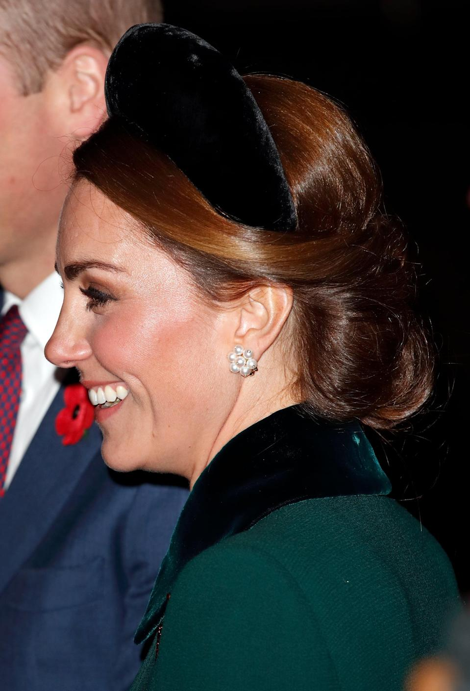 <p>At a celebration marking the centenary of Amristice at Westminster Abbey in 2018, Middleton switched out a jewel-encrusted tiara for a chunky velvet Alice band - marking her as one of the key initiators of the headband trend that would hit the fashion industry in 2019. How she styled it - with one of her low, looped-up chignons with the face-framing pieces crisscrossed across the back of her head, something she does quite often - isn't just an aesthetic choice. The hairstyle actually helps keep the accessory in place, holding the ends of the band close to her head without the need of pins. </p>