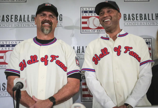 New York Yankees shortstop Derek Jeter, right, and Colorado Rockies outfielder Larry Walker pose after receiving their Baseball Hall of Fame Jerseys, Wednesday Jan. 22, 2020, during a news conference in New York. (AP Photo/Bebeto Matthews)