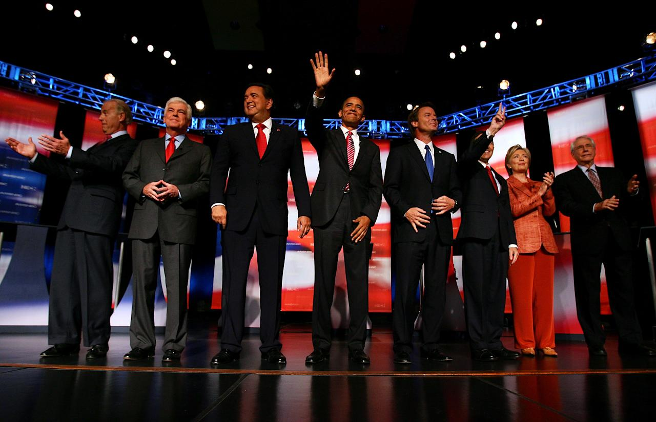 "Democratic presidential candidates (L-R) U.S. Senator Joe Biden (D-DE), U.S. Senator Chris Dodd (D-CT),  New Mexico Governor Bill Richardson, U.S. Senator Barack Obama (D-IL), former U.S. Senator John Edwards (D-NC), U.S. Representative Dennis Kucinich, (D-OH), U.S. Senator Hillary Clinton (D-NY), and former U.S. Senator Mike Gravel (D-AK) pose for photographers before their debate at Dartmouth College in Hanover, New Hampshire  September 26, 2007.   REUTERS/Lisa Hornak/File Photo                  FROM THE FILES PACKAGE ""THE CANDIDATES"" - SEARCH CANDIDATES FILES FOR ALL 90 IMAGES"