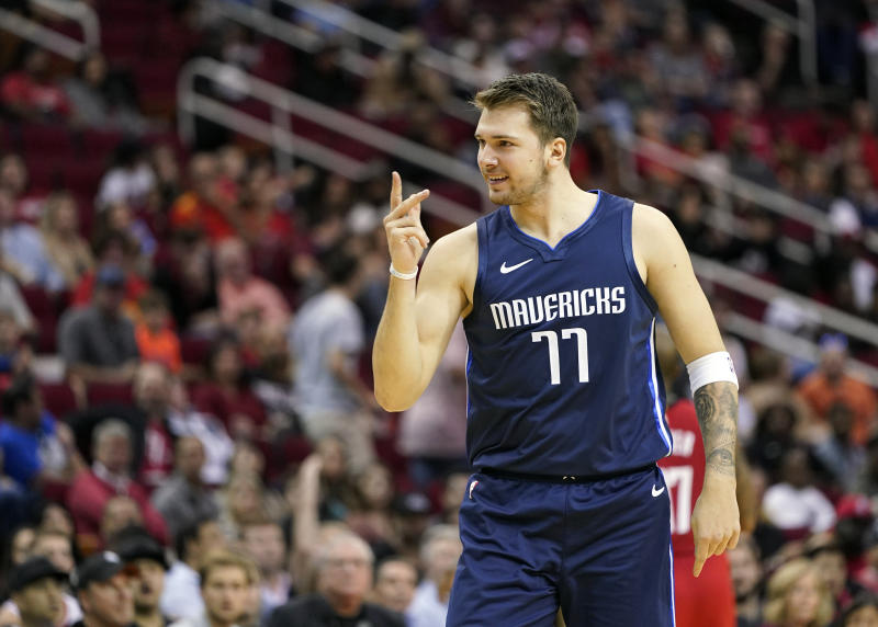 Dallas Mavericks' Luka Doncic reacts after making a basket while being fouled during the first half of an NBA basketball game against the Houston Rockets Sunday, Nov. 24, 2019, in Houston. (AP Photo/David J. Phillip)