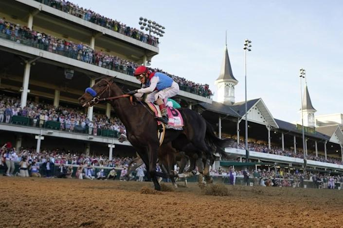 John Velazquez riding Medina Spirit crosses the finish line to win the 147th running of the Kentucky Derby at Churchill Downs, Saturday, May 1, 2021, in Louisville, Ky. (AP Photo/Jeff Roberson)