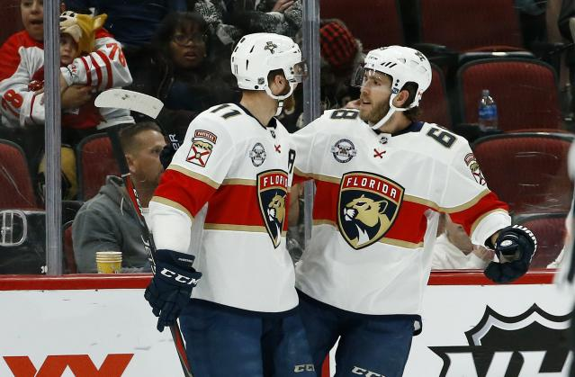 Florida Panthers left wing Mike Hoffman (68) celebrates his goal against the Arizona Coyotes with Jonathan Huberdeau (11) during the second period of an NHL hockey game Tuesday, Feb. 26, 2019, in Glendale, Ariz. (AP Photo/Ross D. Franklin)