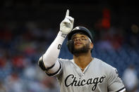 Chicago White Sox's Yoan Moncada gestures as he crosses home plate after hitting a solo home run in the second inning of an interleague baseball game against the Washington Nationals, Tuesday, June 4, 2019, in Washington. (AP Photo/Patrick Semansky)