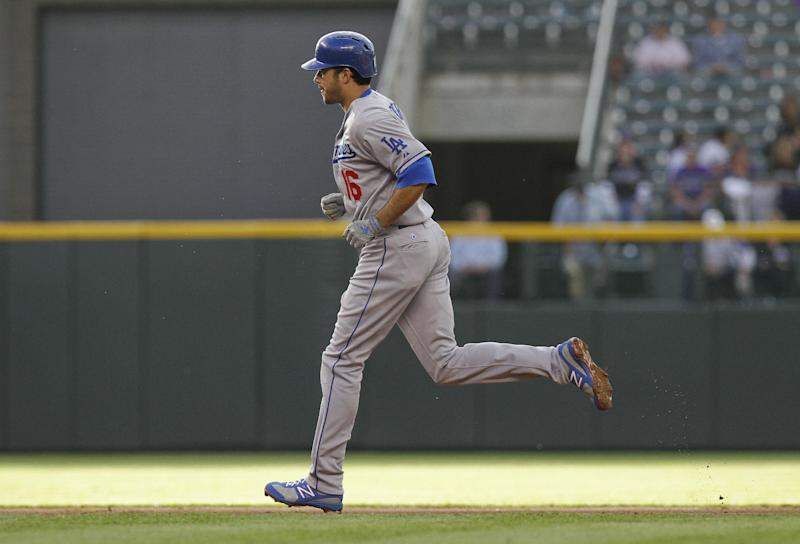 Los Angeles Dodgers ' Andre Ethier (16) rounds the bases after hitting a three-run home run against the Colorado Rockies during the first inning of a baseball game Tuesday, May 1, 2012 in Denver. (AP Photo/Barry Gutierrez)