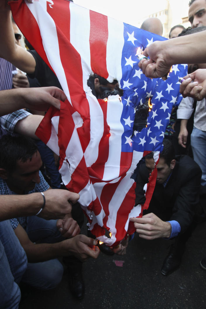 Palestinians burn a U.S. flag during a protest as part of widespread anger across the Muslim world about a film ridiculing Islam's Prophet Muhammad in the West Bank city of Nablus, Friday, Sept.14, 2012. (AP Photo/Nasser Ishtayeh)