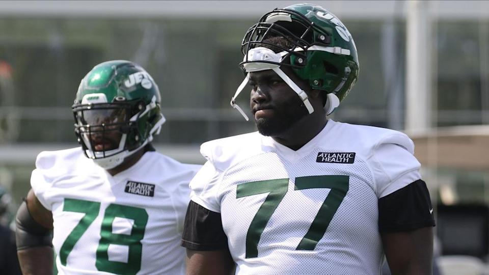 Jul 28, 2021; Florham Park, NJ, USA; Offensive linemen Morgan Moses and Mekhi Becton during drills as the New York Jets hold their first practice of training camp at their practice facility in Florham Park, NJ on July 28, 2021.