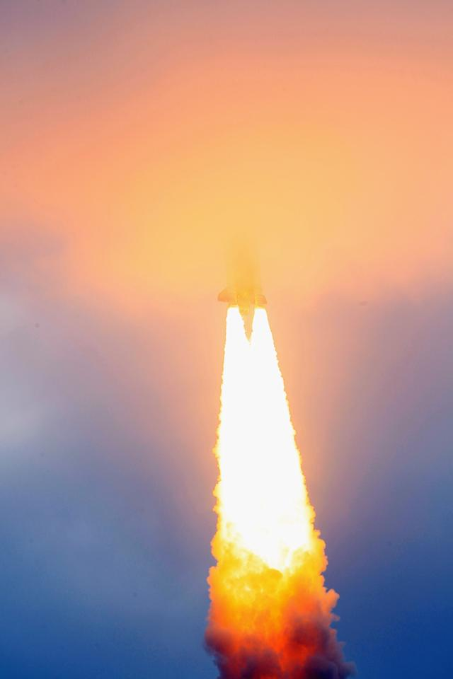 CAPE CANAVERAL, FL - MAY 16:  NASA space shuttle Endeavour disappears in to a cloud as it lifts off from Launch Pad 39A at the Kennedy Space Center on May 16, 2011 in Cape Canaveral, Florida. After 20 years, 25 missions and more than 115 million miles in space, Endeavour is on its final flight to the International Space Station before being retired and donated to the California Science Center in Los Angeles. Capt. Mark E. Kelly, Gabrielle Giffords's husband, will lead mission STS-134 as it delivers the Express Logistics Carrier-3 (ELC-3) and the Alpha Magnetic Spectrometer (AMS-2) to the International Space Station.  (Photo by Joe Raedle/Getty Images)