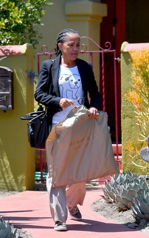 Doria was spotted with a Burberry garment bag on her way to LA-X airport earlier this week - Credit: The Mega Agency