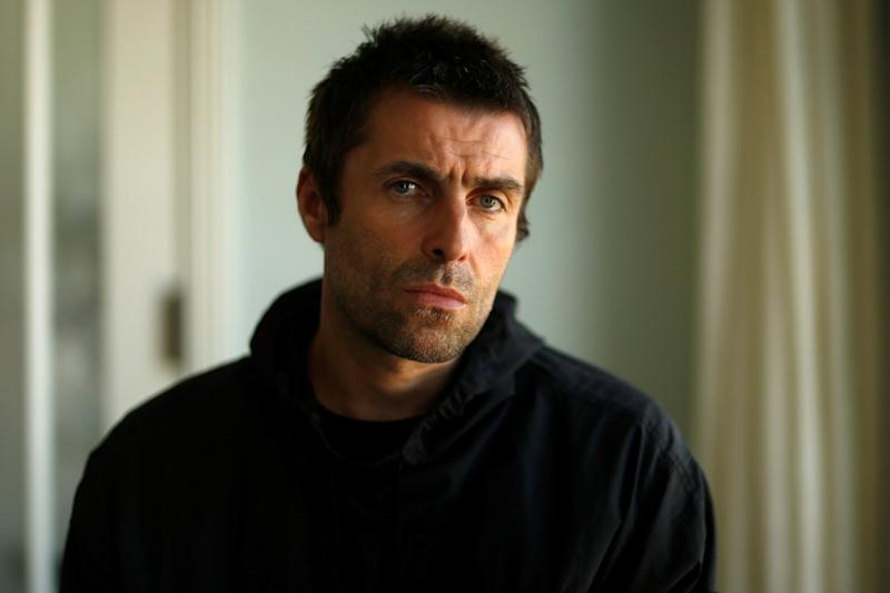 Having a pop: Liam Gallagher is not impressed by the BRITs: Splash News