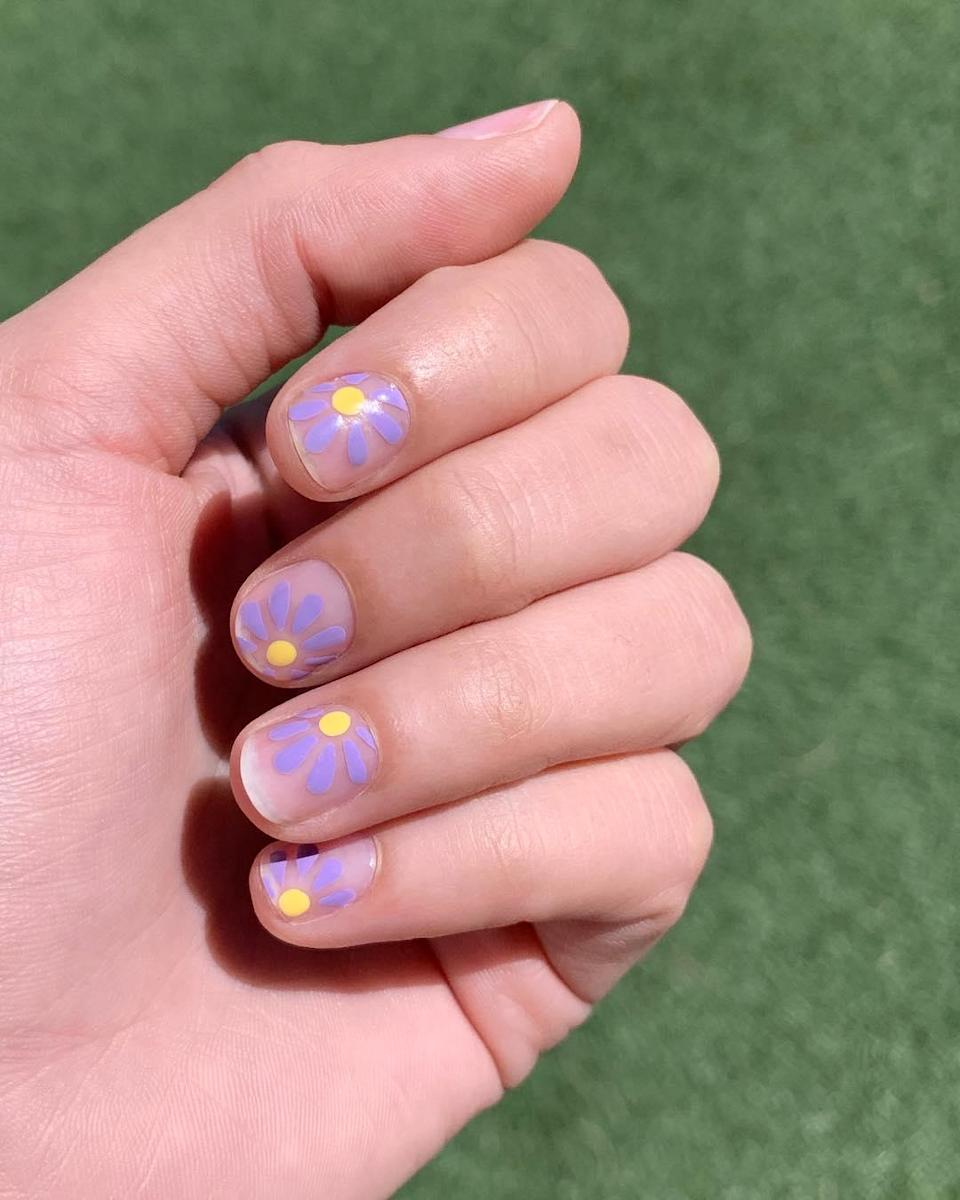 """If you have more of a minimal vibe, skip a background color and let the flowers do all the talking. Nail artist <a href=""""https://www.instagram.com/nataliepavloskinails/"""" rel=""""nofollow noopener"""" target=""""_blank"""" data-ylk=""""slk:Natalie Pavloski"""" class=""""link rapid-noclick-resp"""">Natalie Pavloski</a> used Essie Gel Couture in <a href=""""https://www.amazon.com/Essie-Gel-Couture-Studded-Silhouette/dp/B076T9W1DC"""" rel=""""nofollow noopener"""" target=""""_blank"""" data-ylk=""""slk:Studded Silhouette"""" class=""""link rapid-noclick-resp"""">Studded Silhouette</a> and <a href=""""https://www.amazon.com/Essie-Gel-Couture-Avant-Garment-0-46oz/dp/B002XODK8U"""" rel=""""nofollow noopener"""" target=""""_blank"""" data-ylk=""""slk:Avant-Garment"""" class=""""link rapid-noclick-resp"""">Avant-Garment</a> for this particular look."""