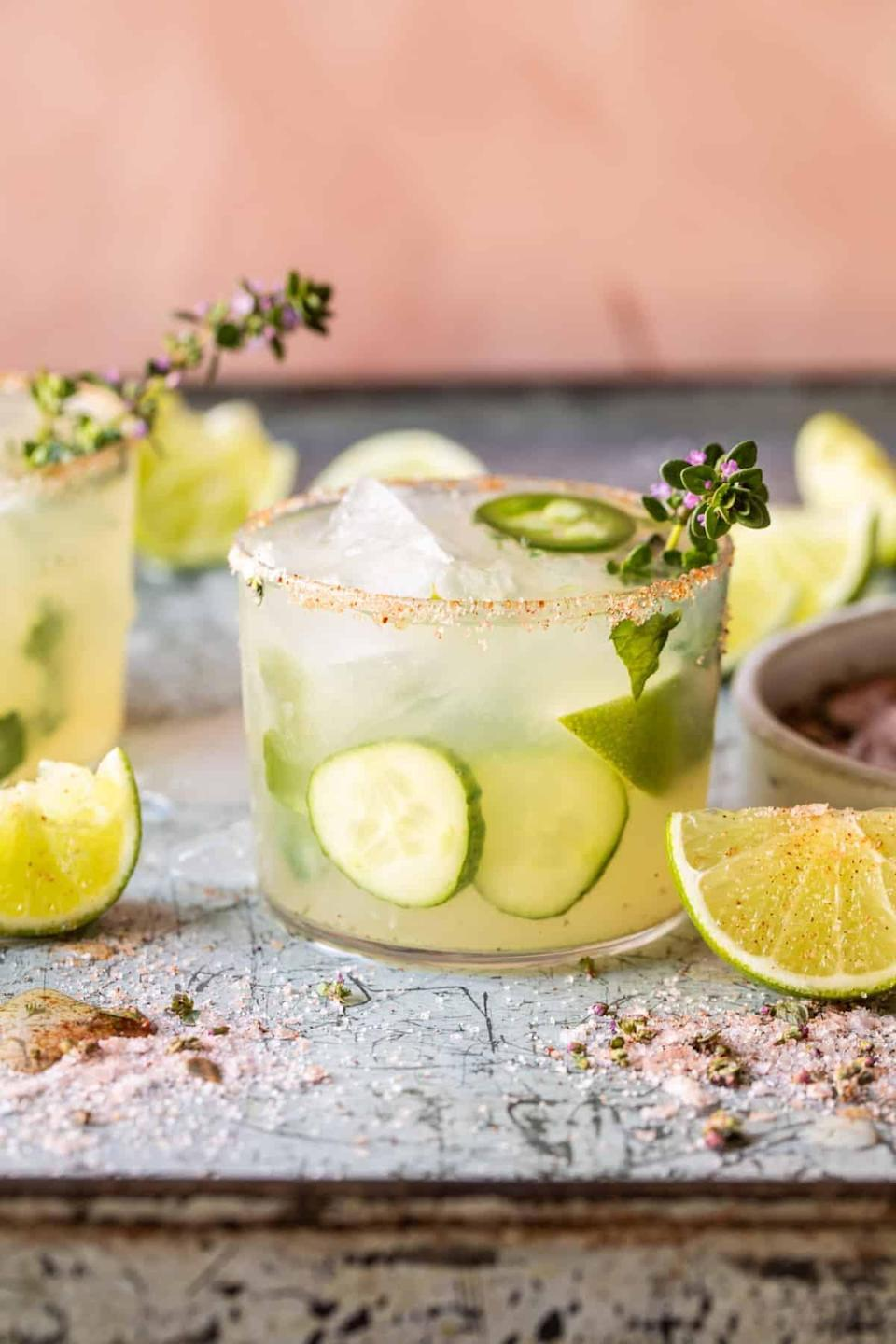 """<p>Imagine: tequila mixed with fresh lime juice, cucumbers, spicy jalapeños, and topped off with ginger beer. It has a fizzy twist and spicy kick, providing your taste buds with everything they could dream of. Not to mention, it also boasts one of Mardi Gras fun colors!</p> <p><strong>Get the recipe</strong>: <a href=""""https://www.halfbakedharvest.com/spicy-cucumber-margarita/"""" class=""""link rapid-noclick-resp"""" rel=""""nofollow noopener"""" target=""""_blank"""" data-ylk=""""slk:spicy cucumber margarita"""">spicy cucumber margarita</a></p>"""