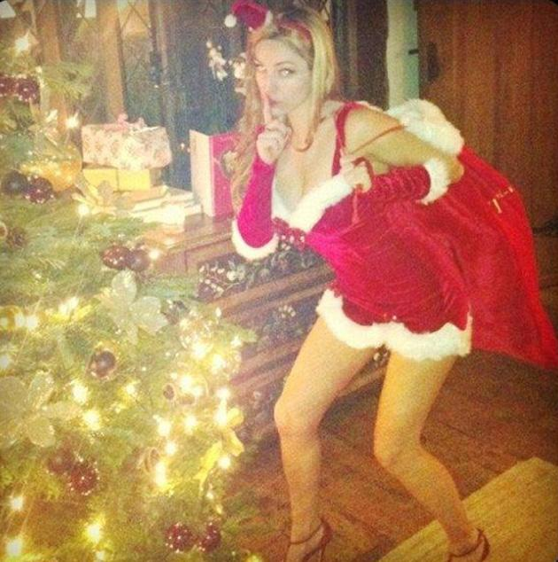 Model Kelly Brook was a sexy Santa creeping up to the Christmas tree.