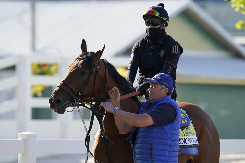 Preakness hopeful Concert Tour is walked to the track for a morning exercise at Pimlico Race Course ahead of the Preakness Stakes horse race, Tuesday, May 11, 2021, in Baltimore. (AP Photo/Julio Cortez)