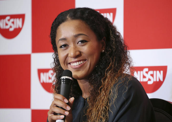 In this Thursday, Sept. 13, 2018, file photo, Naomi Osaka, the champion of U.S. Open women's singles, smiles during a press conference in Yokohama. Osaka defeated Serena Williams of the U.S. on Saturday, Sept. 8, to become the first Grand Slam singles champion from Japan. (AP Photo/Koji Sasahara, FIle)