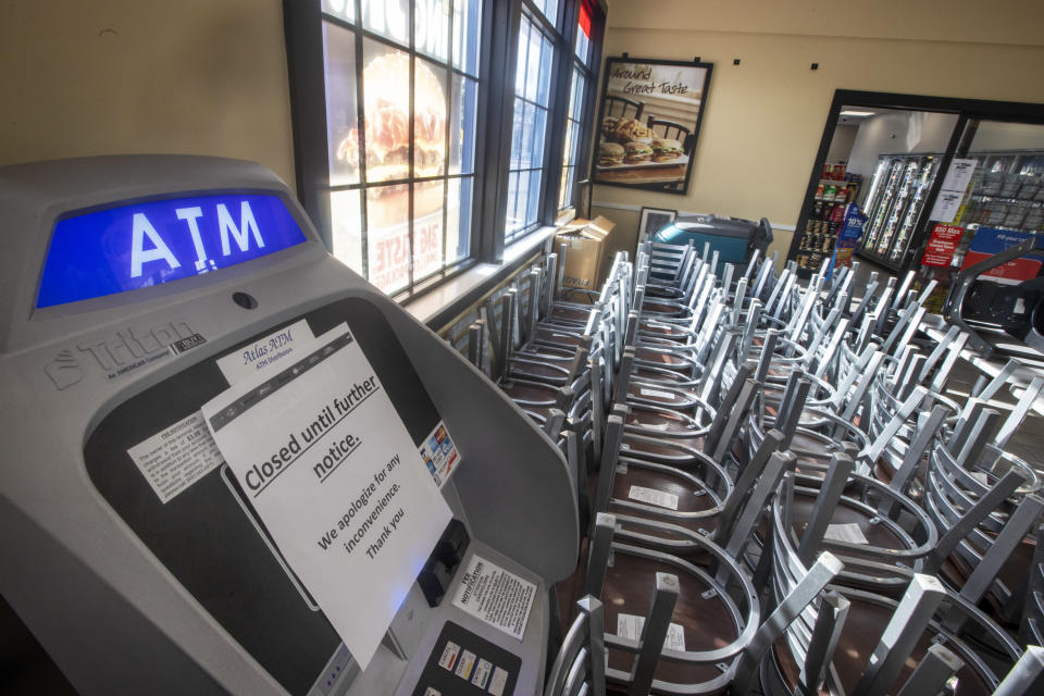 The ATM is closed and chairs are piled up in the empty food court of a rest stop on Route 24 north in Bridgewater, MA at 4:30 p.m. on March 16, 2020. (Photo by Stan Grossfeld/The Boston Globe via Getty Images)