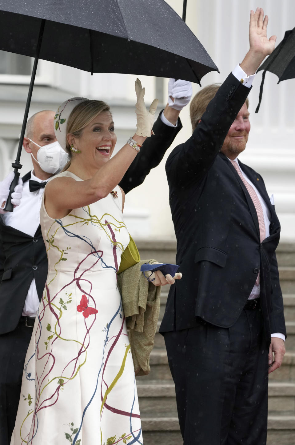 Dutch King Willem-Alexander, right and his wife Queen Maxima, front left, wave as they arrive for a meeting with German President Frank-Walter Steinmeier in Berlin, Germany, Monday, July 5, 2021. King Willem-Alexander and Queen Maxima are on a three day visit in Germany. (AP Photo/Michael Sohn)