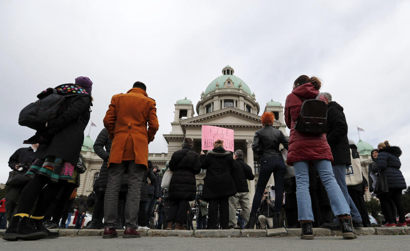 """In this photo taken Monday, Feb. 24, 2020, a participant holds a banner that reads: """"Where are our Children"""", during a protest in front of the parliament building in Belgrade, Serbia. After years of waiting, Serbian lawmakers are set to soon pass a bill that authorities say attempts to shed light on a chilling, decades-old scandal involving hundreds of families who suspect their babies were stolen at birth. (AP Photo/Darko Vojinovic)"""