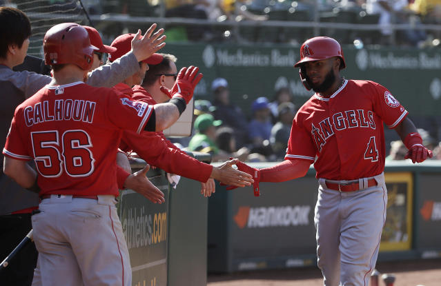 Los Angeles Angels' Luis Rengifo, right, celebrates with teammates after scoring a run against the Oakland Athletics during the 11th inning of a baseball game in Oakland, Calif., Wednesday, May 29, 2019. (AP Photo/Jeff Chiu)