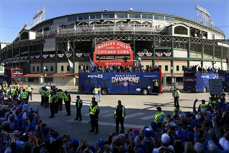 a2d3cb6b06d A parade honoring the World Series champion Chicago Cubs passes Wrigley  Field. (AP)