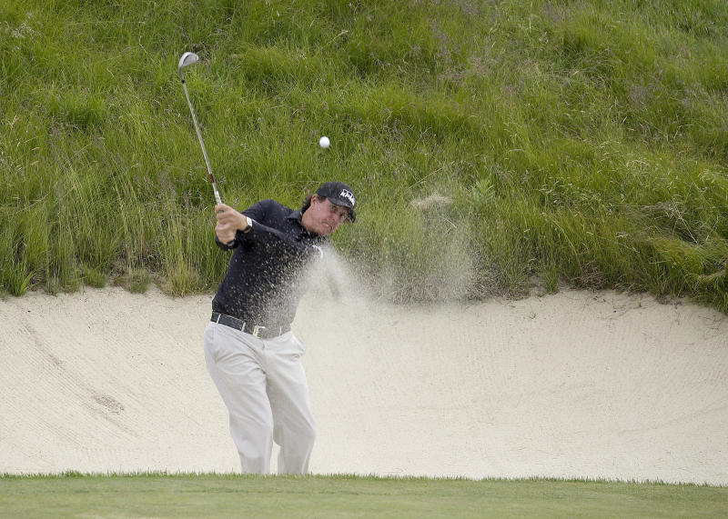 Phil Mickelson hits out of a bunker during a practice round for the U.S. Open Golf Championship Wednesday