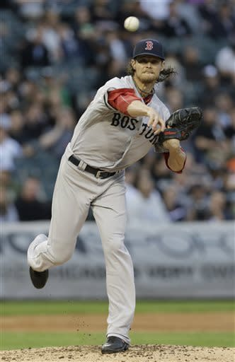 Boston Red Sox starter Clay Buchholz throws to first base during the first inning of a baseball game against the Chicago White Sox in Chicago, Wednesday, May 22, 2013. (AP Photo/Nam Y. Huh)