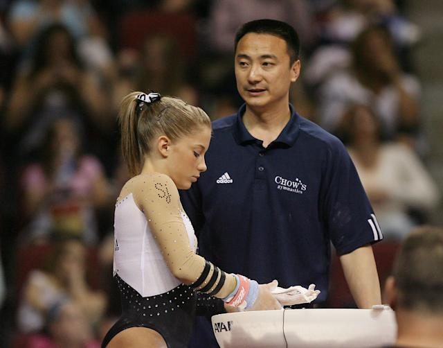 Liang Chow talks with Shawn Johnson during day 3 of the Visa Championships at Agganis Arena June 7, 2008 in Boston, Massachusetts.