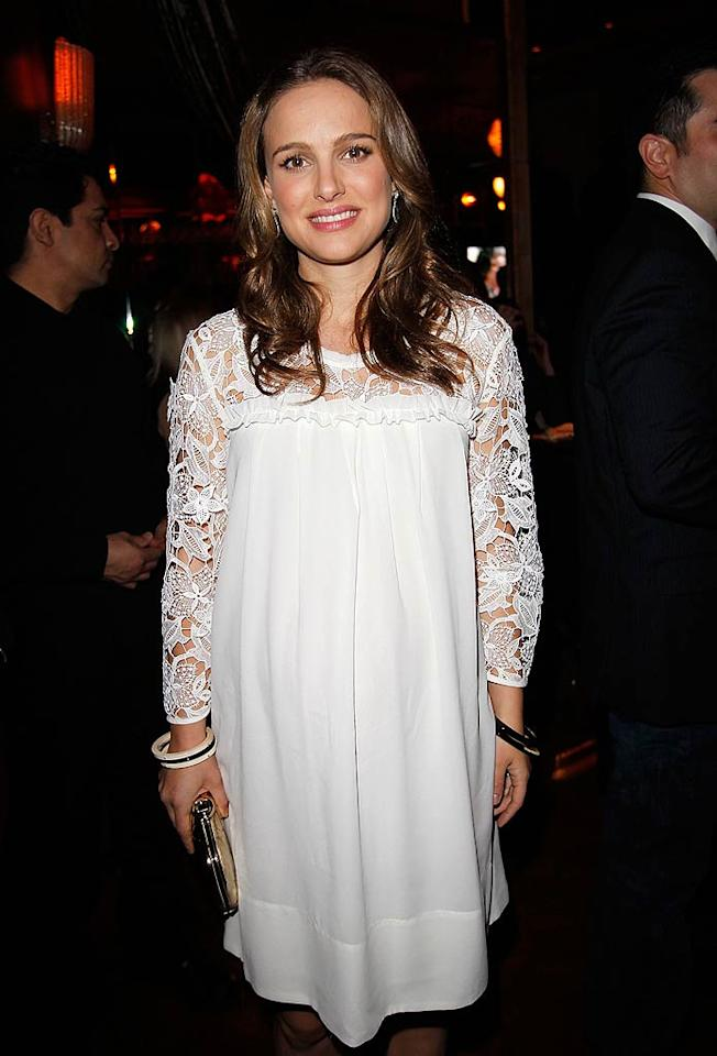 "Also at the star-studded bash was Mila's ""Swan"" co-star Natalie Portman, who covered her growing bump in a pretty cream lace smock. Natalie is the favorite to win Best Actress at the Academy Awards on Sunday. Do you think she'll take home the prize? Donato Sardella/<a href=""http://www.gettyimages.com/"" target=""new"">GettyImages.com</a> - February 24, 2011"