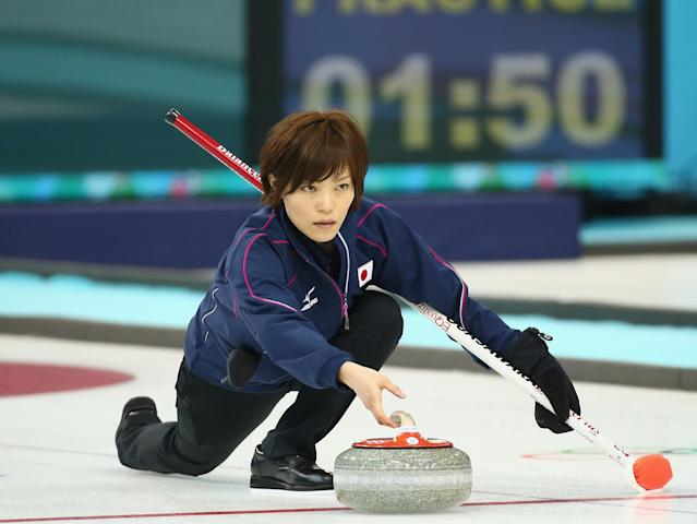 SOCHI, RUSSIA - FEBRUARY 08: Ayumi Ogasawara of Japan release the rock during curling training on day 1 of the Sochi 2014 Winter Olympics at the Ice Cube on February 8, 2014 in Sochi, Russia. (Photo by Robert Cianflone/Getty Images)