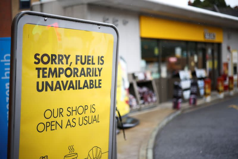 FILE PHOTO: A sign informing customers that fuel has run out is pictured at a Shell fuel station in London