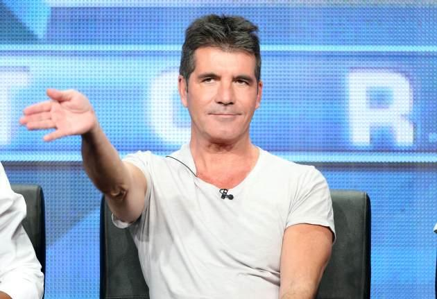 """Simon Cowell speaks onstage during the """"The X Factor"""" panel discussion at the FOX portion of the 2013 Summer Television Critics Association tour - Day 9 at The Beverly Hilton Hotel on August 1, 2013 -- Getty Images"""
