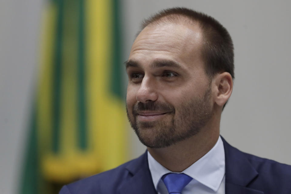 FILE - In this Aug. 14, 2019 file photo, Eduardo Bolsonaro, a Brazilian lawmaker and the son of President Jair Bolosonaro, smiles during a Foreign Relations Committee ceremony, in Brasilia, Brazil. Eduardo Bolsonaro has assumed leadership of their political party, the Social Liberal Party, in Congress' lower house, an update of the chamber's website showed Monday, Oct. 21, 2019.  (AP Photo/Eraldo Peres, File)