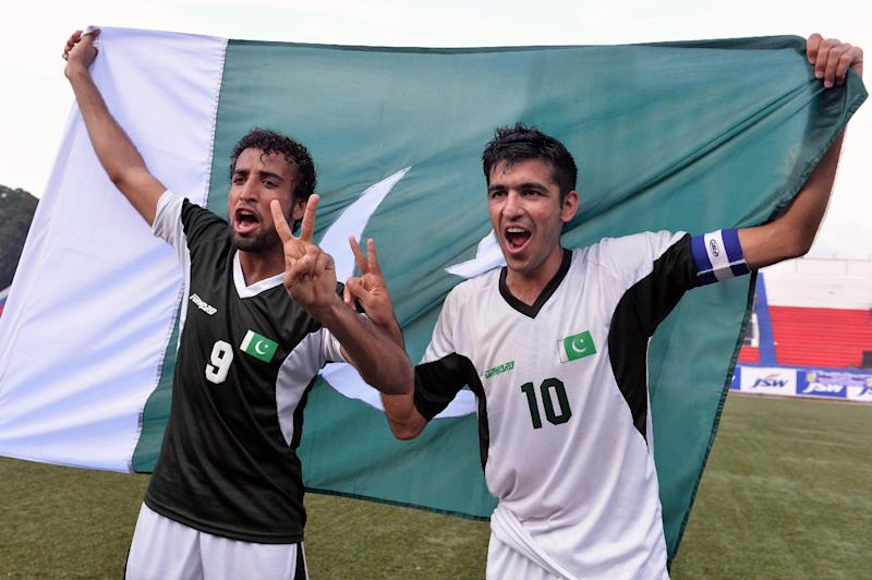 Pakistan's football captain Kaleem Ullah (R) celebrates with teammate Abdul Salam after their two-goal victory against India in a friendly match in Bangalore on August 20, 2014