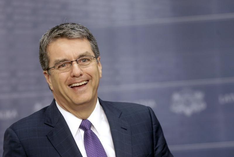World Trade Organization (WTO) Director-General Azevedo smiles as he speaks during a news conference in Riga