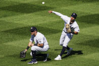 New York Yankees second baseman Thairo Estrada, right, throws towards home plate after a ball dropped for an RBI single by Baltimore Orioles' Ryan Mountcastle in the sixth inning of a baseball game, Saturday, Sept. 12, 2020, in New York. At left is Mike Tauchman. (AP Photo/John Minchillo)