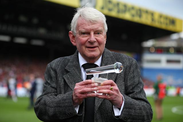 "Soccer Football - Premier League - Crystal Palace vs West Bromwich Albion - Selhurst Park, London, Britain - May 13, 2018 Commentator John Motson holds up an award he was presented after the match REUTERS/Hannah McKay EDITORIAL USE ONLY. No use with unauthorized audio, video, data, fixture lists, club/league logos or ""live"" services. Online in-match use limited to 75 images, no video emulation. No use in betting, games or single club/league/player publications. Please contact your account representative for further details."