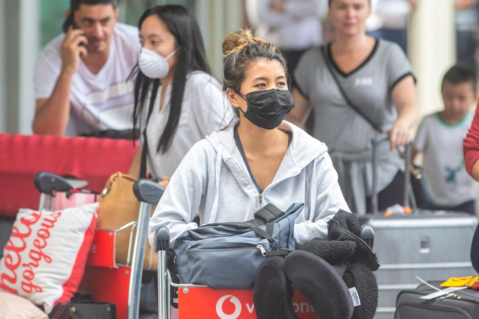 Arrivals at Sydney airport wearing masks.