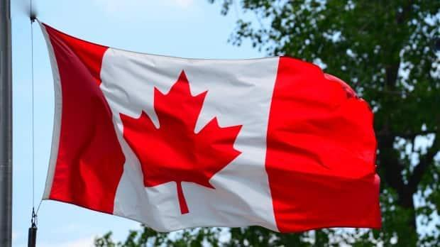 The federal government lowered Canadian flags to half mast at its buildings in May, after the discovery of hundreds of unmarked graves at residential schools in Canada.  (Jean-Claude Taliana/CBC - image credit)