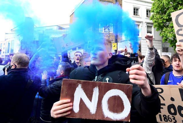 Chelsea fans gather outside Stamford Bridge to protest against plans for their club to join the European Super League. English football was rocked by the proposals, which prompted widespread anger and considerable opposition following their announcement on April 18. The project, which also included Arsenal, Liverpool, Manchester City, Manchester United and Tottenham, was scrapped just two days later
