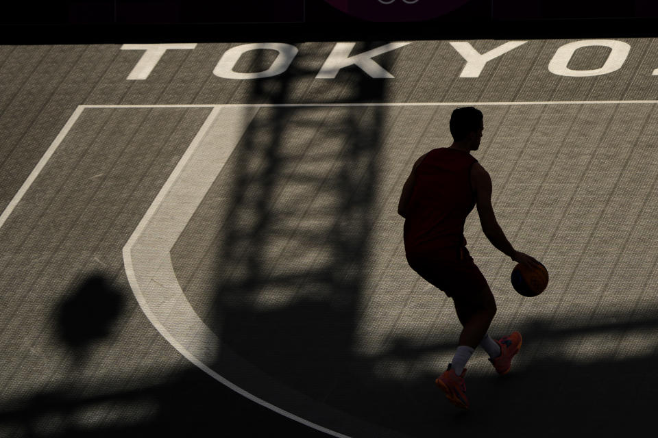 An athlete from Belgium practices for the 3x3 basketball competition at the 2020 Summer Olympics, Wednesday, July 21, 2021, at the Aomi Urban Sports Park in Tokyo. (AP Photo/Charlie Riedel)