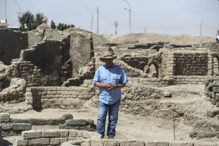 Dr. Zahi Hawass talks to media in a 3,000-year-old lost city in Luxor province, Egypt, Saturday, April 10, 2021. The newly unearthed city is located between the temple of King Rameses III and the colossi of Amenhotep III on the west bank of the Nile in Luxor. The city continued to be used by Amenhotep III's grandson Tutankhamun, and then his successor King Ay. (AP Photo/Mohamed Elshahed)