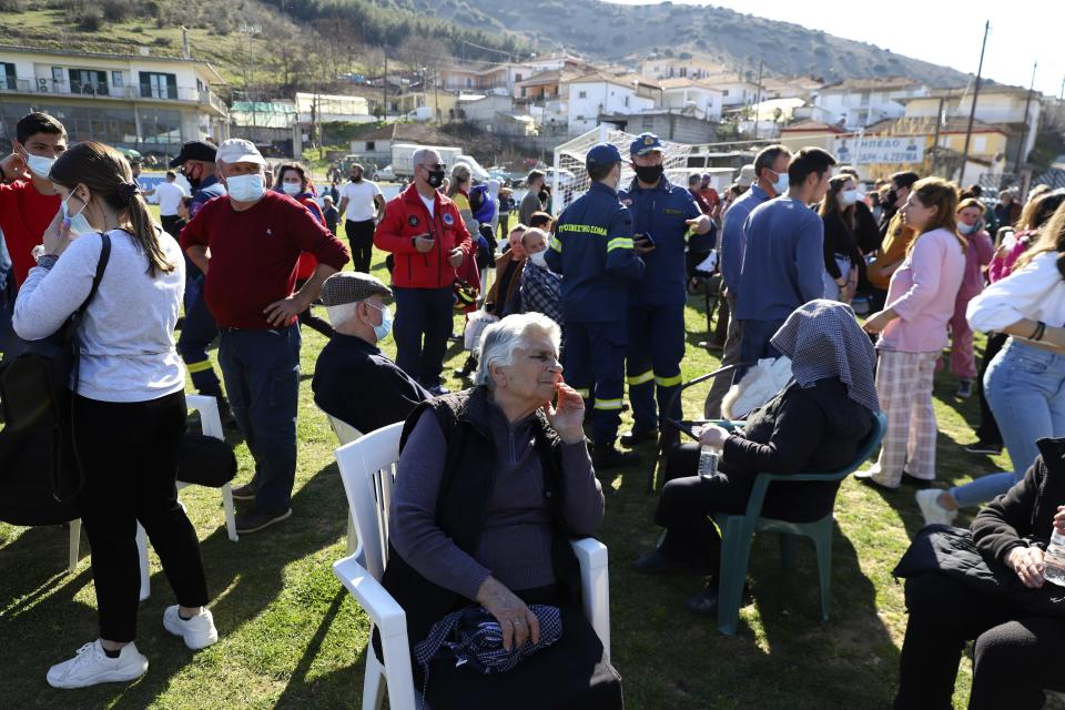 Local residents gather at a soccer field after an earthquake in Damasi village, central Greece, Wednesday, March 3, 2021. An earthquake with a preliminary magnitude of up to 6.3 struck central Greece on Wednesday and was felt as far away as the capitals of neighboring Albania, North Macedonia, Kosovo and Montenegro. (AP Photo/Vaggelis Kousioras)
